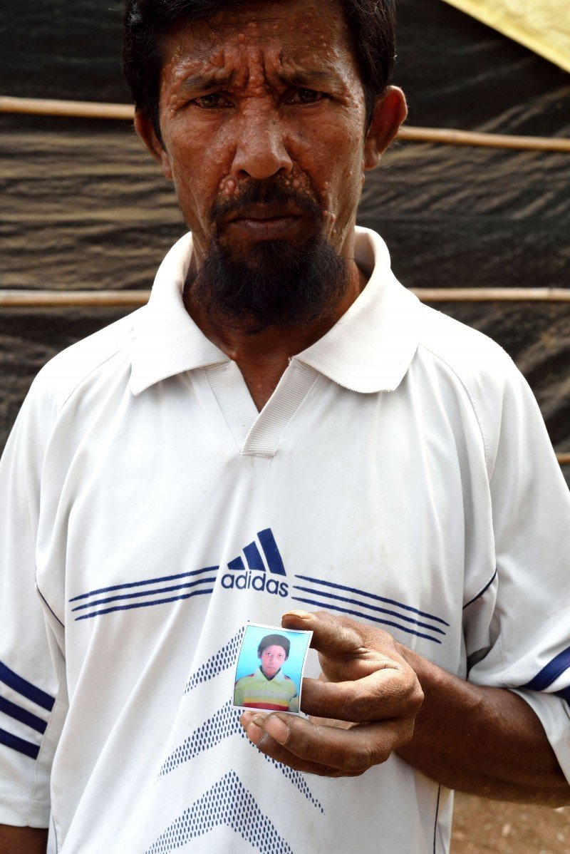 While on their way to Hyderabad, Mohammed's son got off at a train stop and couldn't get back to the train in time. It has been four years since Mohammed last saw him, at the station. (Kashif Ali)