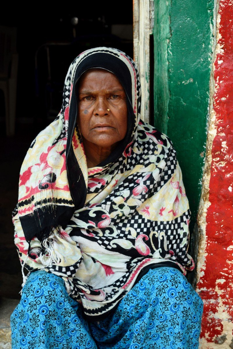 Altaas is 70 years old and lives by herself. She collects garbage around the neighborhood and makes 50 rupees – less than a dollar – per day. (Kashif Ali)