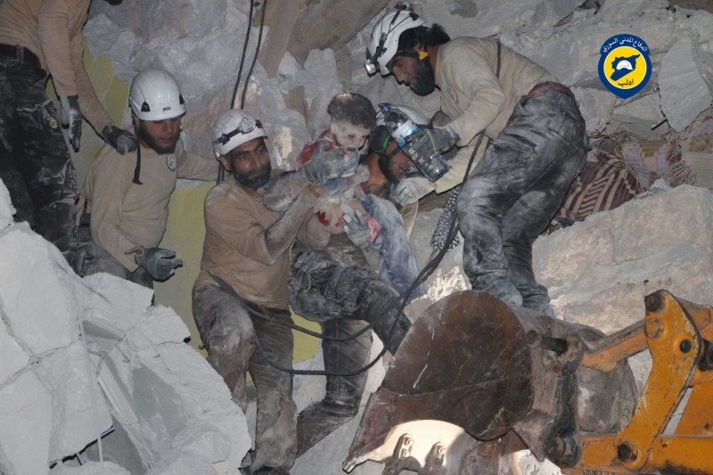 Workers from the White Helmets rescue a child trapped under rubble in Idlib city, Idlib province, on May 31, 2016. (Syria Civil Defense)
