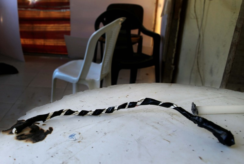 A whip on a table in the guard's room of the Chez Maurice Hotel in Maameltein, north of Beirut, Lebanon. (AP/Hussein Malla)