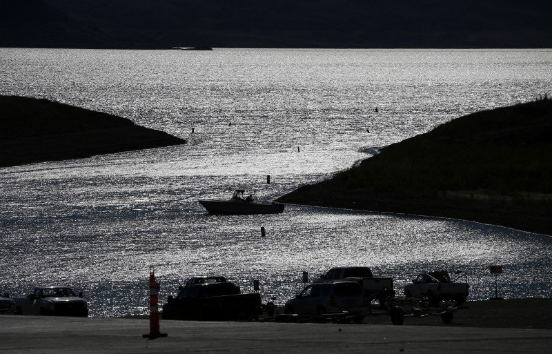 A boater drifts toward a boat ramp in an area that was once under water at the Lake Mead National Recreation Area, May 19, 2016, near Las Vegas. The lake has a hit a record low water level. (John Locher, AP)