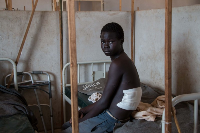 In November 2015, bombs fell on the border, close to the Maban refugee and host communities. Two women were killed and 15-year-old Jima Pame was badly injured by shrapnel. He was brought to the only referral hospital in all Upper Nile state, where he spent four months recovering. (Ashley Hamer)