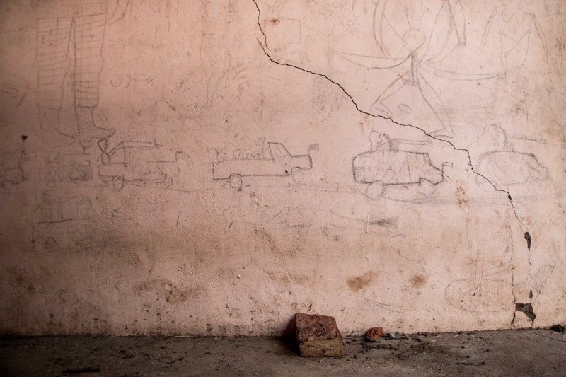 Graffiti scrawled on the wall of a school building in Doro refugee camp, Maban. The school was closed and occupied for most of 2015 by a battalion of several hundred soldiers during South Sudan's civil war. (Ashley Hamer)