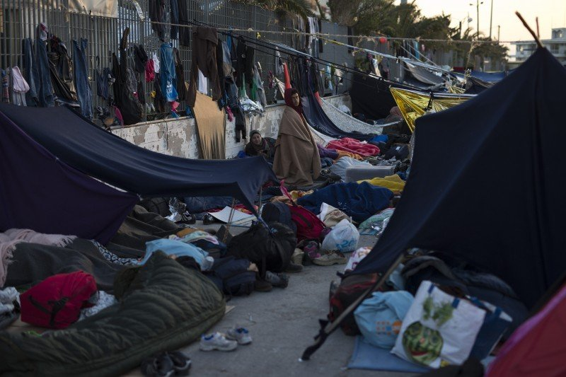 Migrants and refugees sleep at the port of the Greek island of Chios, Wednesday, April 6, 2016. (AP/Petros Giannakouris)