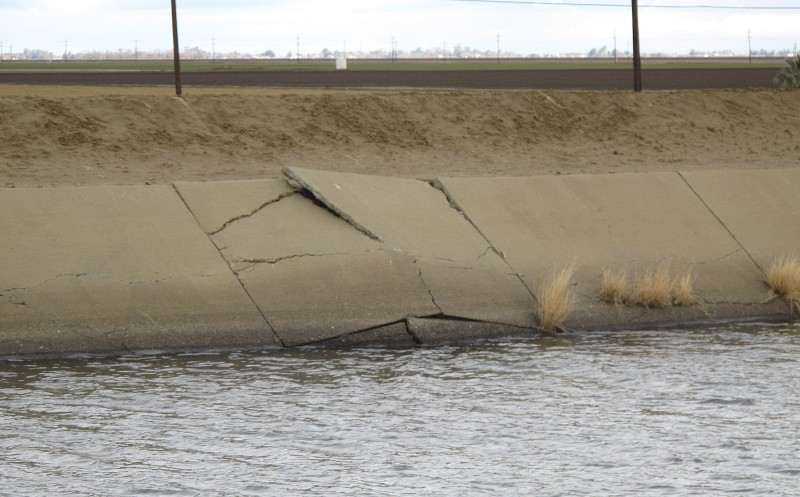 This buckle in the lining of the Delta Mendota Canal near Dos Palos, California, was caused by sinking land. Drought and heavy reliance on the pumping of groundwater have made the land sink faster than ever up and down California's Central Valley. (Scott Smith, AP)