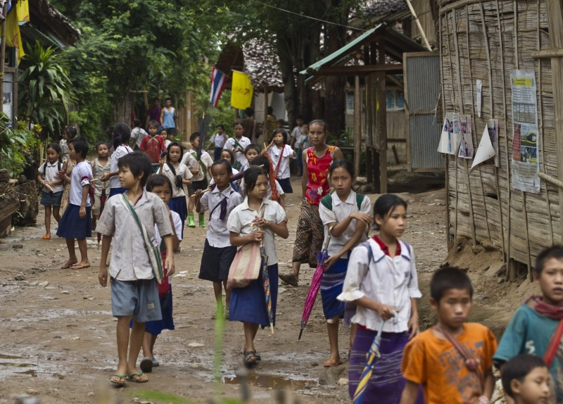 Ethnic Karen children leave school at the Mae Rama Luang Refugee Camp in western Thailand, along the border with Myanmar. (AP/David Longstreath)
