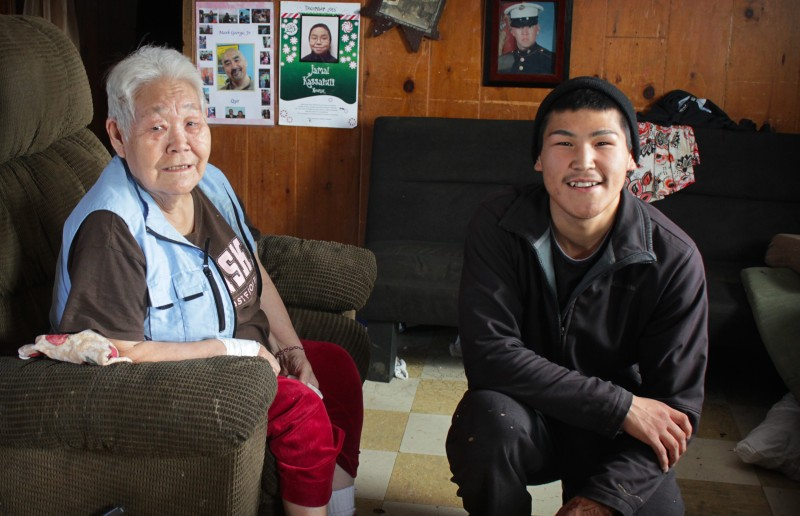 Mary John – with her informal translator, local teenager Scott Charlie – remembers when her community first started warning of changes to the Alaskan tundra. (Madeline Ostrander)