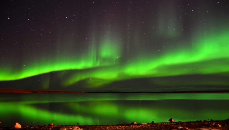 Lights of the aurora borealis illuminate the night in Cambridge Bay, Nunavut, on September 24, 2014.