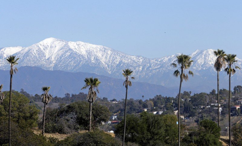 The snow-capped San Gabriel Mountains look over Chinatown in downtown Los Angeles Tuesday, Jan. 12, 2016. The mountains are a critical watershed for the L.A. area. (Nick Ut, AP)