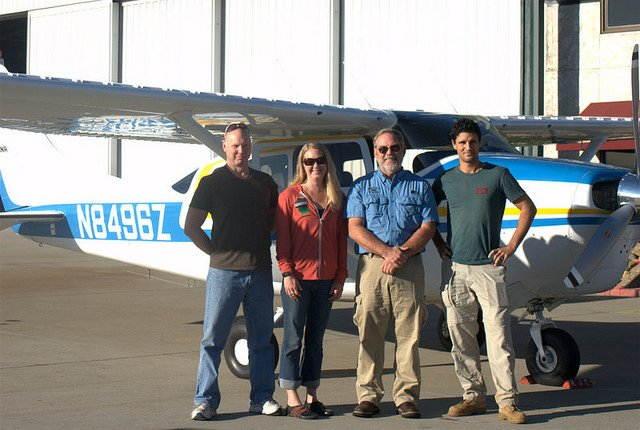 Jeffrey Moore, shown at far left, with fellow survey crew members and the aircraft they use to count dead trees in the Southern Sierra Nevada. (U.S. Forest Service)