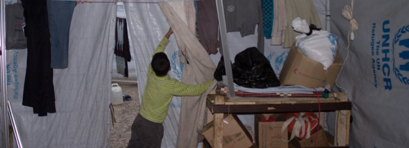 Umm ʿAbdu's son, ʿAbdu, in the family's tent in government-controlled Tartus. (Ghenwa Yusuf/Good Morning Syria)