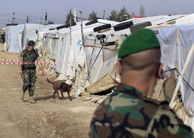 Lebanese army soldiers patrol a Syrian refugee camp, in the town of Dalhamyeh, in the Bekaa valley ahead of a high level official's visit. UNHCR is not permitted to freely register Syrian refugees without interference from the Lebanese government. (AP/Bilal Hussein)