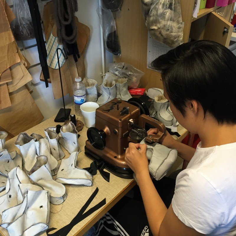 Larsen works at the sewing machine she uses for sealskin. (Jennifer Kingsley)
