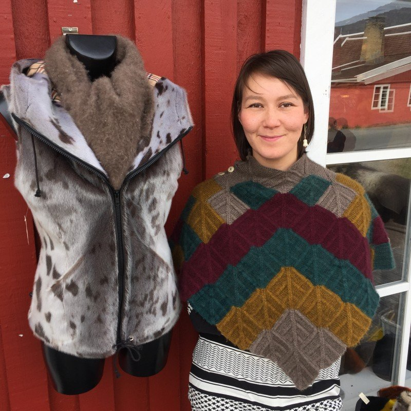 Davidsen in a handmade muskox wool shawl next to one of her sealskin vests. (Jennifer Kingsley)