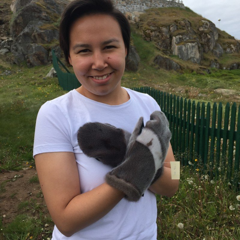 Larsen shows off some of her sealskin mittens. (Jennifer Kingsley)