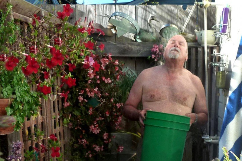 "Capitola City Council member Dennis Norton usually showers in his outdoor shower, where he can easily capture overspray in a bucket to water plants with later. The city is served by Soquel Creek Water District, which is forgoing the state's ""stress test"" process in favor of a 25 percent water conservation requirement. (Soquel Creek Water District)"