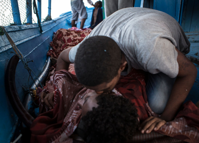 One of the 352 survivors grieves the death of his friend. One in 50 Eritreans sought asylum in Europe since 2012. (MOAS/Mathieu Willcocks)