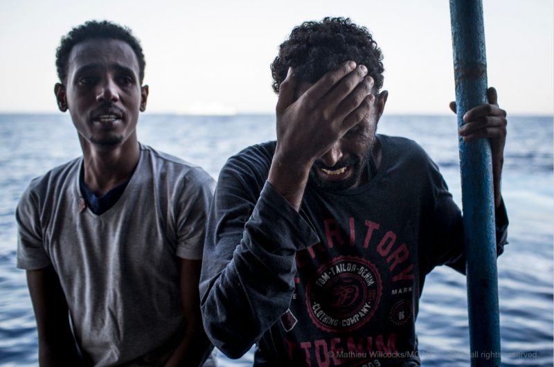 Two of the rescued men are overwhelmed with emotion. The government of Eritrea has imposed emergency rule since 1998, when it fought a war against Ethiopia. (MOAS/Mathieu Willcocks)