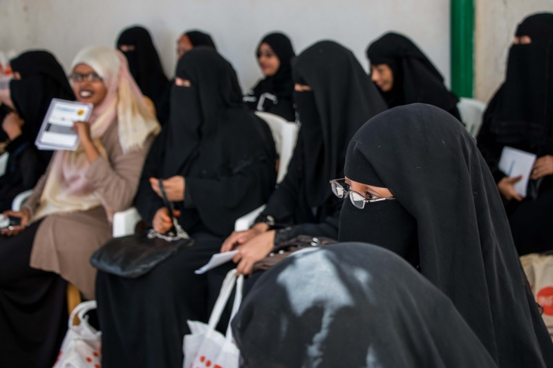 "The United Nations refugee agency (UNHCR) provides some assistance to refugees arriving in Somaliland from Yemen. Here, Yemeni women in Hargeisa wait to receive information and basic ""dignity kits,"" which include sanitary products, clean underwear and basic toiletries. (Ashley Hamer)"