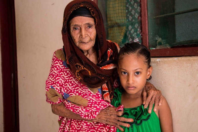 The oldest and youngest members of the Salim family fled Dubab, their native village near the Babal Mandab seaport in Yemen, by boat and live in the port city of Berbera, in Somaliland, with 16 other relatives. (Ashley Hamer)