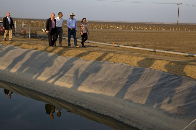 President Barack Obama tours a local farm that has been affected by drought with Calif. Gov. Jerry Brown (left) in Los Banos, Calif., in February 2014. NASA scientists have begun deploying satellites and other advanced technology to help California water officials assess the state's record drought and better manage it. (Jacquelyn Martin, AP)