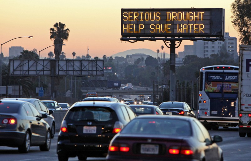 In Feb 2014, morning traffic heads to downtown Los Angeles along the Hollywood Freeway past an electronic sign warning of severe drought. Conservation and water efficiency still remain effective tools for fighting California's drought. (Richard Vogel, AP)