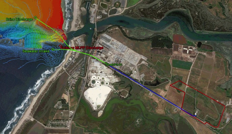 The layout of the proposed Deep Water Desal project in Moss Landing, Calif. The red outline on the right shows the plant location, and the green lines show the proposed intake and discharge pipelines. Elkhorn Slough, a protected natural area, runs along the top of the image, and the Dynegy powerplant is the developed area in the center. (Deep Water Desal)