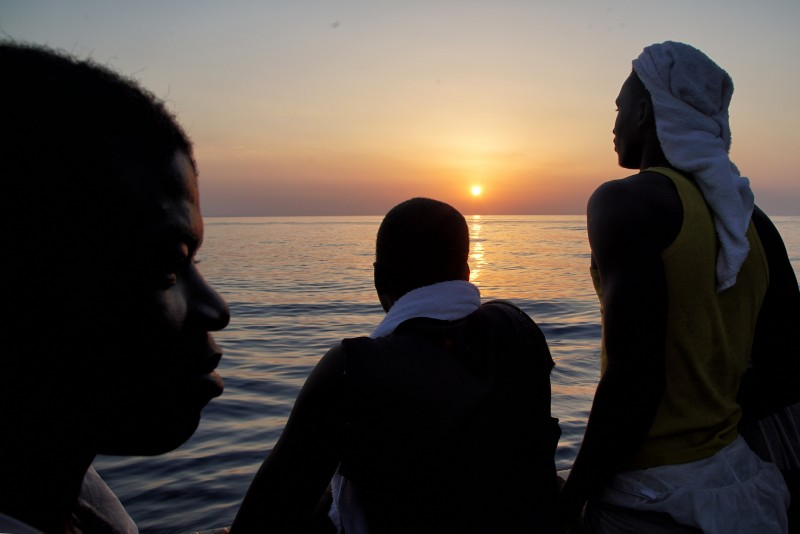 Young men rescued at sea look out from the Aquarius rescue vessel. (AP/Bram Janssen, File)