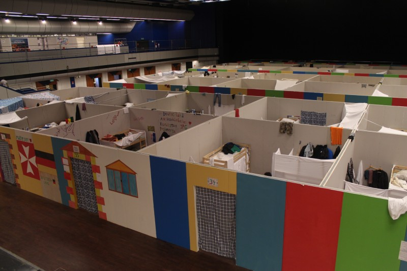 In the International Congress Center in Berlin refugees live in 16x16ft (5x5m) cubicles, without ceilings or windows – and no natural light.
