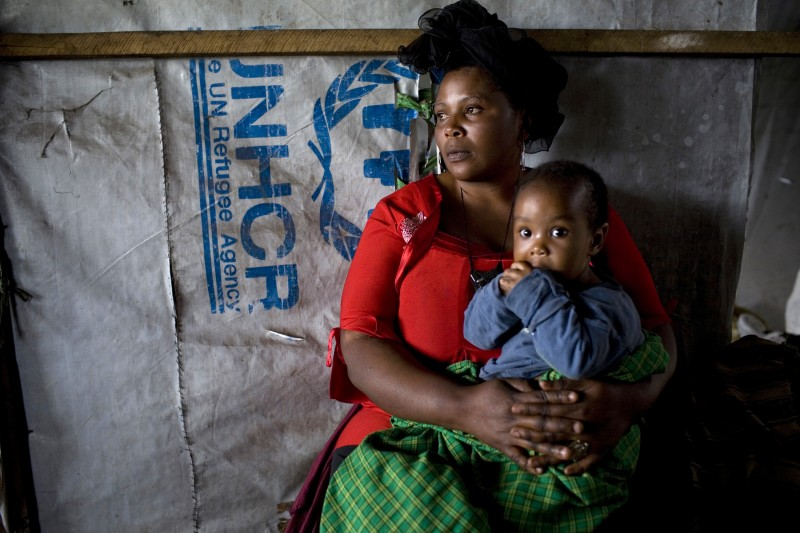 Annie Kabeja, 34, a Congolese woman, holds her baby at a refugee center in Rwanda. Malnourishment amongst young children and babies in rife among refugee populations. (AP/Siegfried Modola)