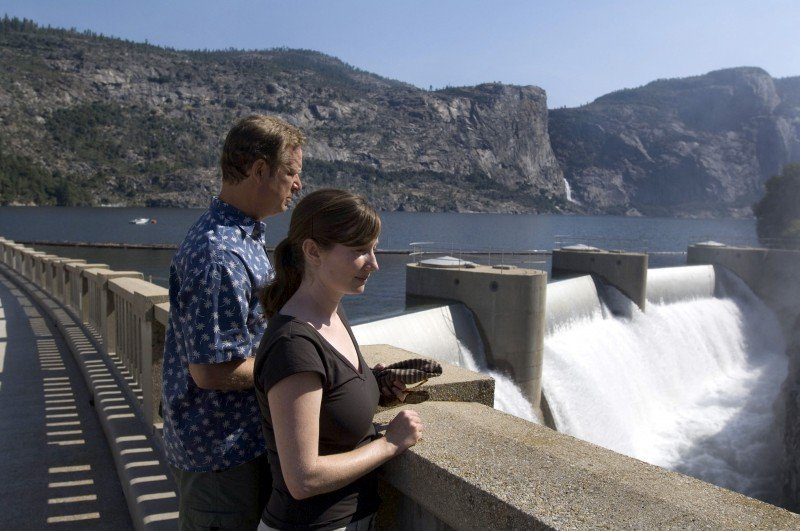 Visits look over O'Shaughnessy Dam near Yosemite National Park, Calif. Hydroelectric power has been impacted by California's drought. (Al Golub, AP)