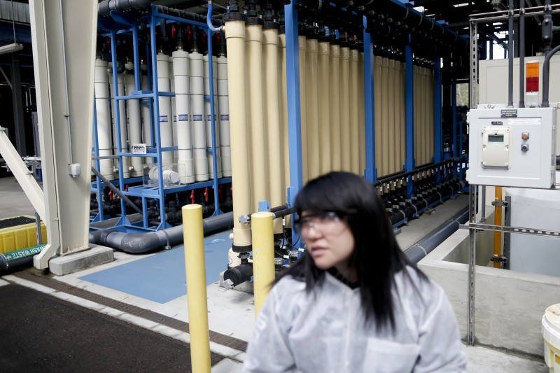 Engineer Elise Chen speaks in front of water purification containers at San Diego's Advanced Water Purification Facility. (Gregory Bull, AP)