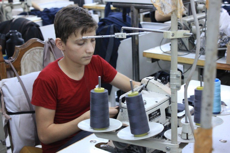 Twelve-year-old Mohammad sews clothes in a factory. All he wants to do is learn maths and teach it some day. (Theirworld)