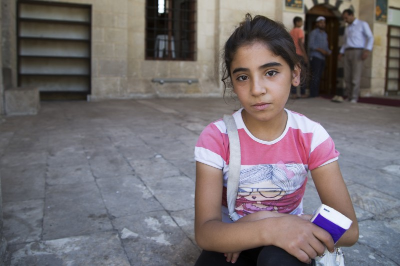 Rima and her siblings have not attended school for four years. They sell tissues and pastries in the streets to make the money they need to survive. (Rosie Thompson/Theirworld)