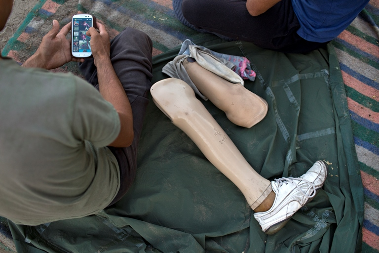 """A 24-year-old man from Afghanistan lost his leg due to a land-mine explosion. He said he fled his country with his wife and two children because, """"the Taliban are killing people."""" (Danielle Villasana)"""