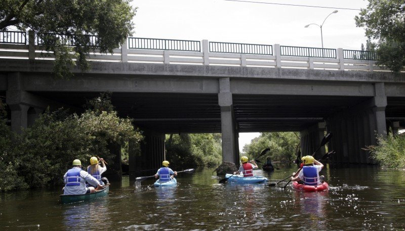 Kayakers paddle down the Los Angeles River. (Noaki Schwartz, AP)