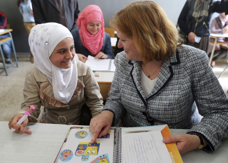 Anne Richard, assistant secretary of state for population, refugees and migration sits with Syrian refugee students in a classroom of a Lebanese public school in Beirut. (AP)