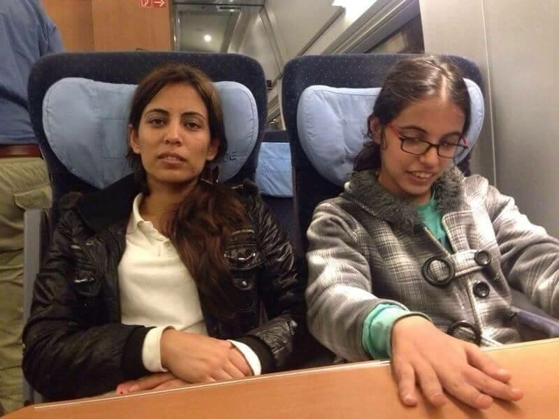 Nujeen and her sister Nasrine on a train near the end of their journey to Cologne. (Nujeen Mustafa)