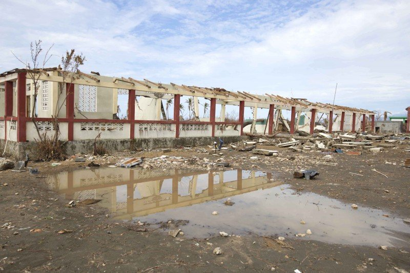 The shell of the Nina Therosier college nursing school is all that remains standing after it was destroyed by Hurricane Matthew, in Aux Coteaux, a district of Les Cayes, Haiti. (AP/Dieu Nalio Chery)