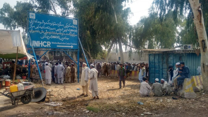 Long queues of Afghan refugees stretch out near the UNHCR repatriation center outside the Pakistani city of Peshawar. (Nabi Jan Orakzai)