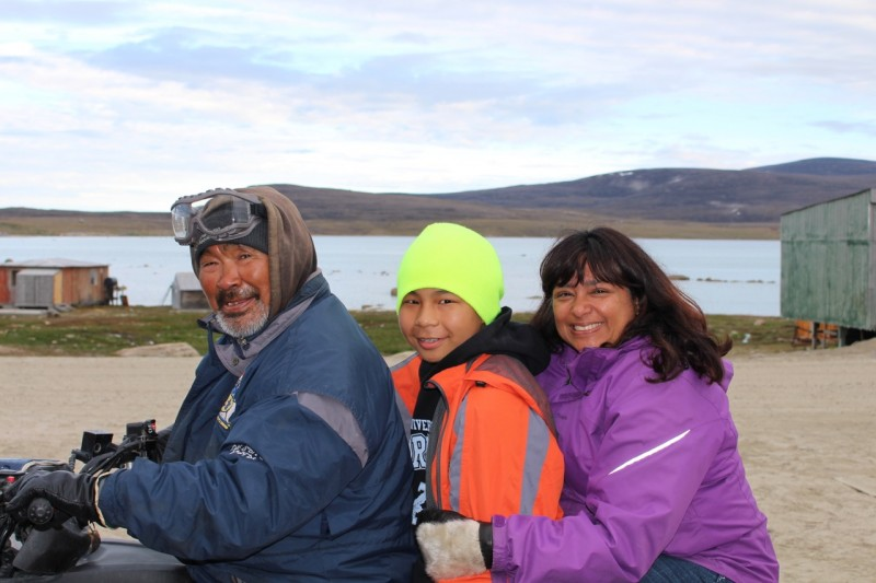 Anna Banerji with son Nathan and his grandfather David Iqaqrialu on a visit to Clyde River, summer 2016. (Anna Banerji)