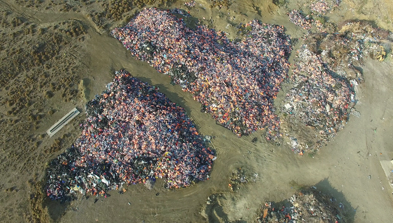 """Called the """"graveyard of life vests,"""" the aerial view of this site located about 45 minutes from Skala Sikamineas is a telling visual of the number of arrivals over the past year. (Iason Athanasiadis)"""