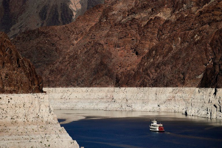 In this Wednesday, Oct. 14, 2015 photo, a riverboat glides across Lake Mead on the Colorado River at Hoover Dam near Boulder City, Nev. The bathtub ring shows how far water level has dropped in recent years. (Jae C. Hong, AP)