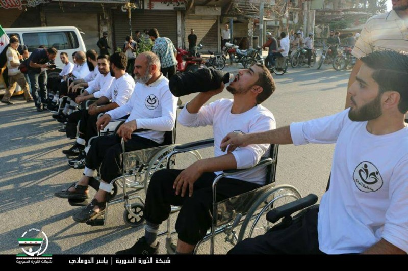 Participants wait at the starting line for the first wheelchair race in Eastern Ghouta. (Syrian Revolution Network)