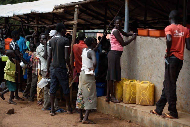 Sarah and Jane waiting for food rations at the Nyumanzi Refugee Transit Center near Adjumani, Uganda. (Jennifer Huxta)