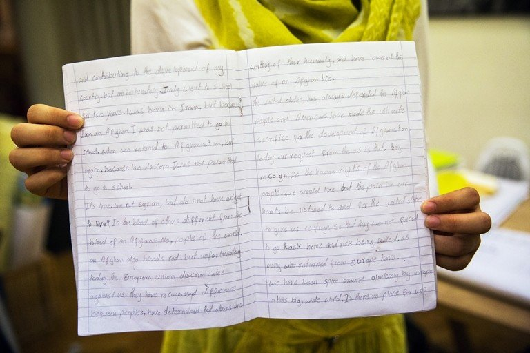 Marzia, 15, from Afghanistan, displays a story she wrote at the Melissa Center in Athens. The Melissa Center is a community space for girls going through difficult times, a place where they can receive support and meet others with similar experiences. (Sarah Hylton/Mercy Corps)