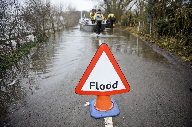 A flood warning sign in the village of Muchelney in Somerset, U.K.. A new report from CDP highlights the business risks from water insecurity caused by both droughts and floods. (Ben Birchall/PA Wire)
