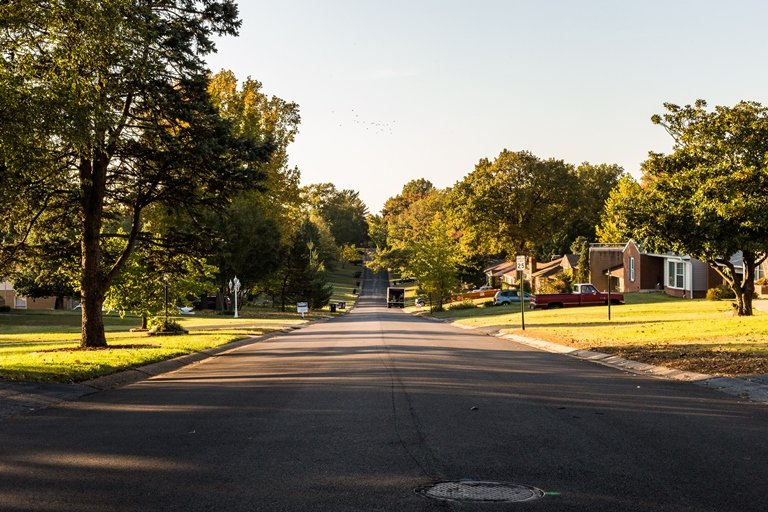 A typical neighborhood of Affton, South St. Louis, where new arrivals continue to be placed. Over the decades, migrants and refugees have added to the local economy. But there remains empty land, despite people's needs. (Nathan Parker).