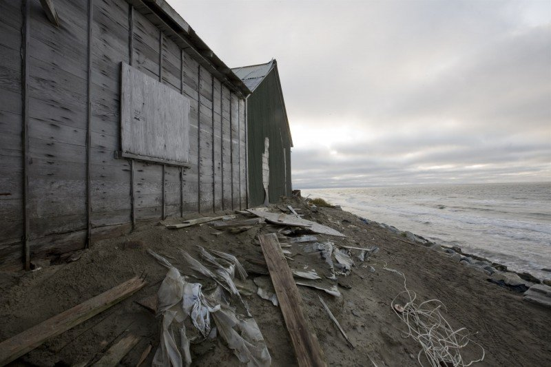 Homes, water systems and infrastructure are being destroyed in Shishmaref, Alaska, as the ocean eats away at the land. (GRID Arendal/Lawrence Hislop)