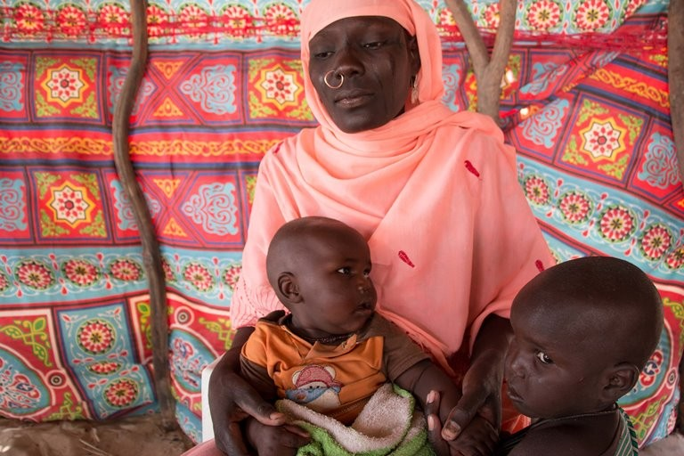 Haje Fanta, 28, from Niger, is caring for two of her children at the refugee camp. (Ashley Hamer)